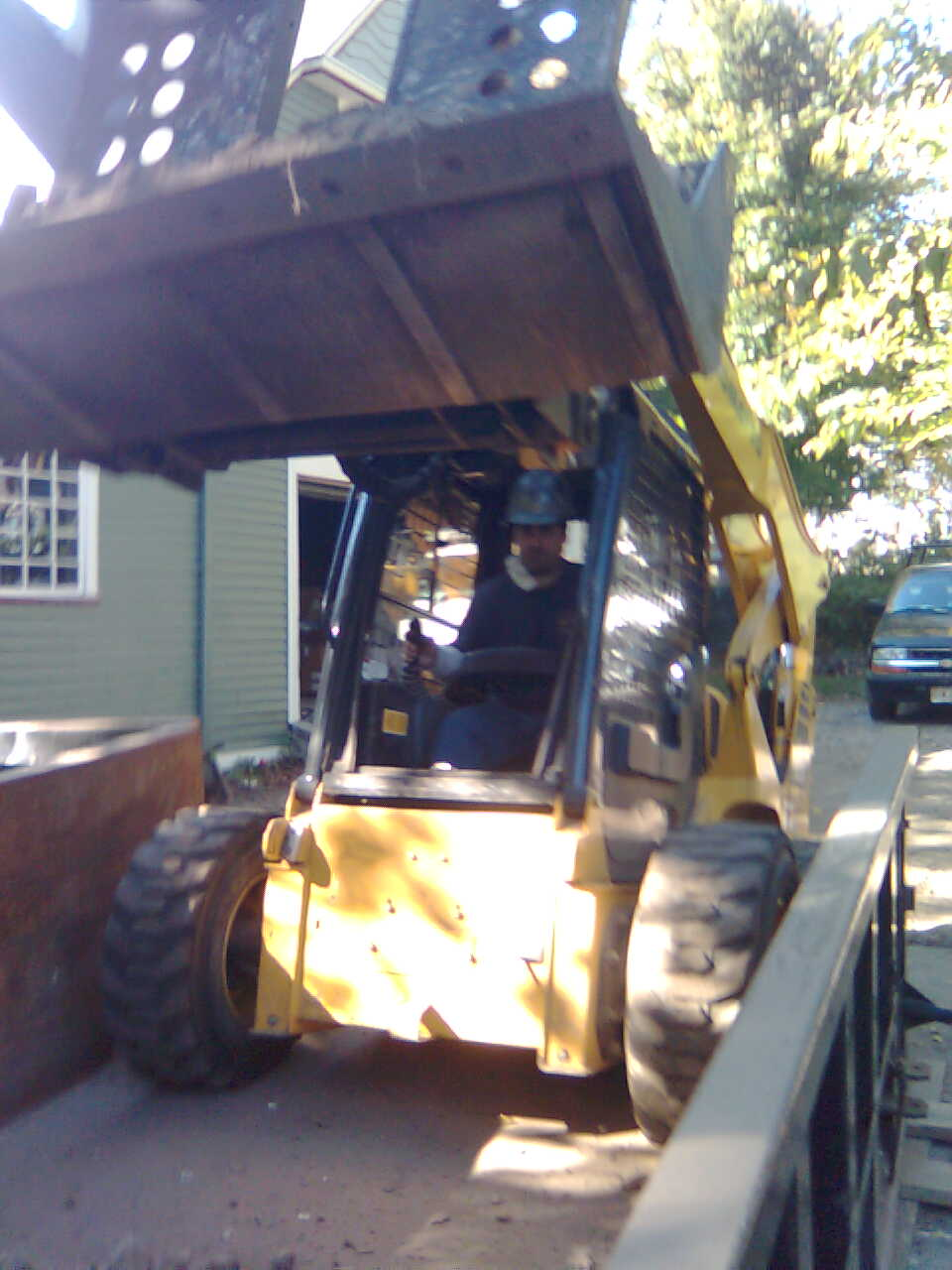 Removal of 70 Ton of dirt out of a basement via Bobcat and Conveyor
